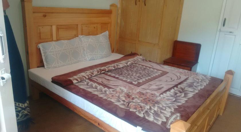 jagran-resort-kutton-colony-swiss-cottage-master-bed-room