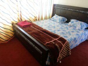 1452592467_Kashmir-Lodges-Sharda-Rooms-bed-luxurios-accommodation-in-sharda-Neelum