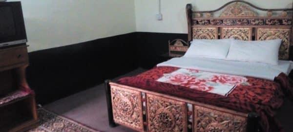 Golden-Star-Hotel-Kalam-bed-room